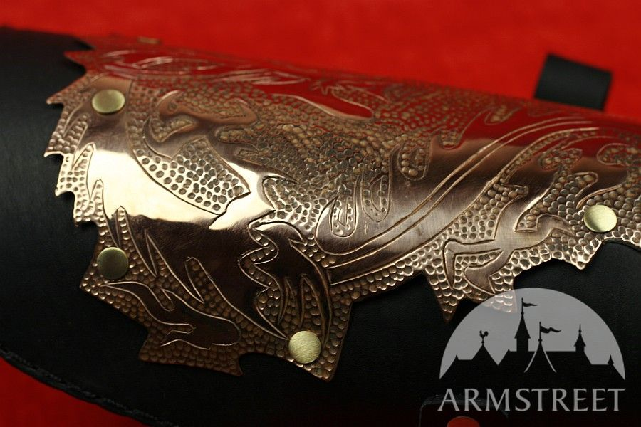 "EXCLUSIVE ""DRAGONS"" BRACERS"