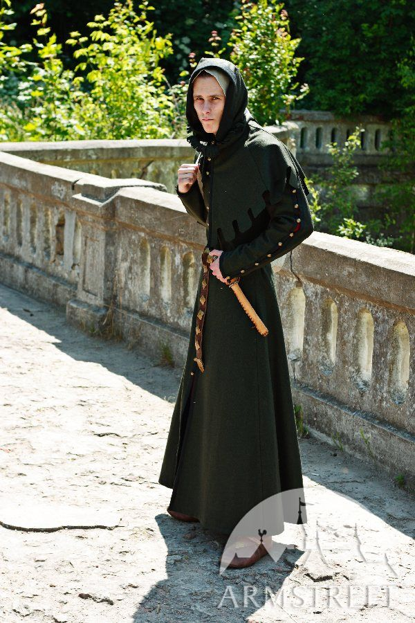 Classic long medieval woolen coat with hood typical for ...
