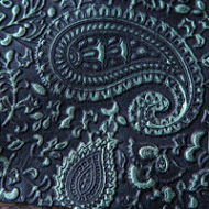 Green on black embossed leather